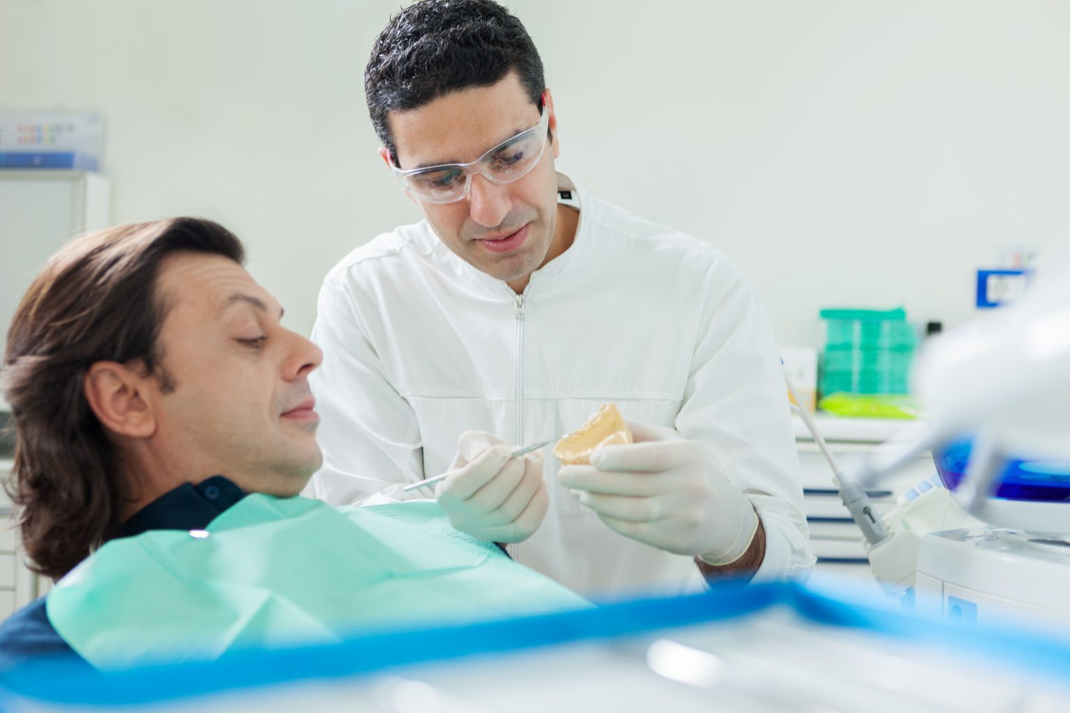 Dentist Is Showing A Plaster Model To His Patient